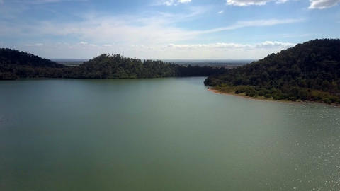 Large Calm Lake among Forestry Hills Aerial View Footage
