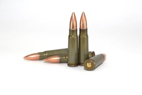Five cartridges for Kalashnikov assault rifles on white background close-up フォト