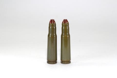 two blank cartridges for a Kalashnikov assault rifle on white background フォト