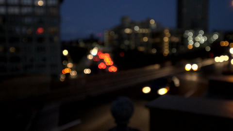 Shot of out of focus car lights moving along a New York freeway Footage
