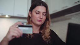 Close-up. Beautiful online women's banking with a credit card at the table Footage