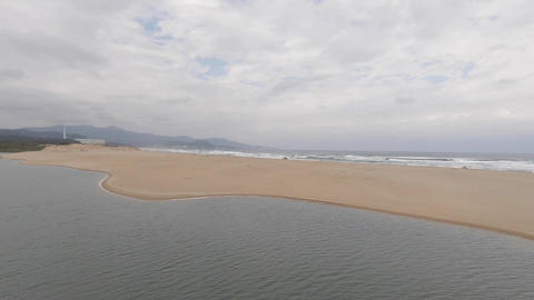Aerial drone shot at Fulong Beach, Taiwan with cloudy sky Live Action