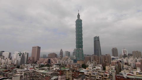 Aerial drone shot above the city of Taipei, Taiwan in a cloudy day Live Action