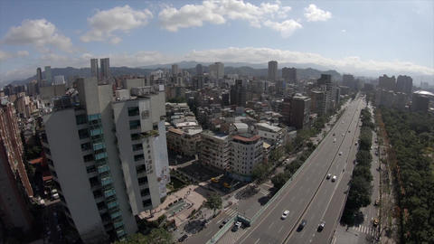 Aerial drone shot above the busy street in the city of Taipei, Taiwan Live Action