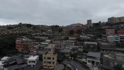 Aerial drone shot at historical Jiufen mountain town in Taiwan Live Action