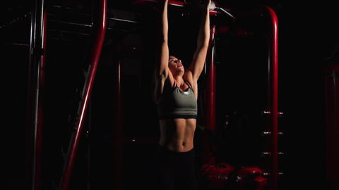 Fitness Woman Performing Hanging Leg Raises Exercise - One Of The Most Effective Footage