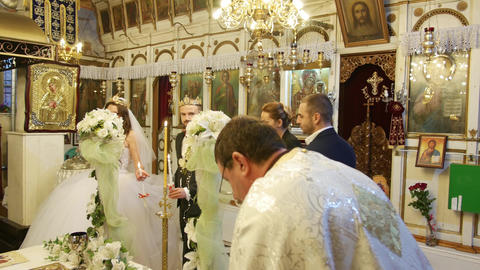 Marriage wedding ritual in orthodox church with priest and sponsors GIF