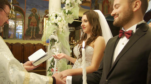 Marriage ritual in a church - young married couple's wedding Footage