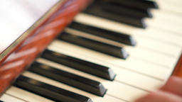 Female fingers playing keys on retro piano keyboard. Shallow depth of field Footage