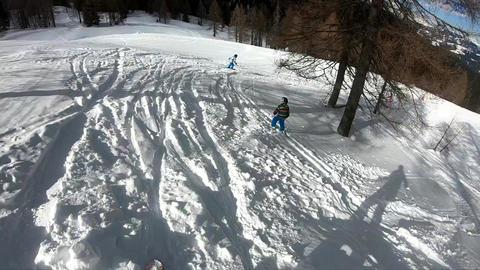 Freeride skiing. Little boy skiing in the wild Footage