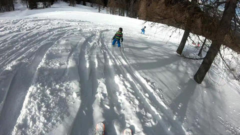 Freeride skiing. Little boy skiing in the wild Stock Video Footage