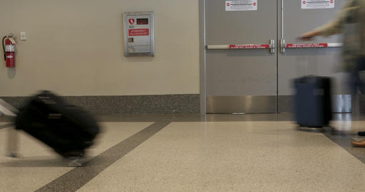 Time lapse of traveling people walking with their carry on luggage in an airport Footage