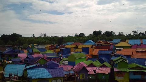 Tilt down of Colorful Village or Kampung Warna Warni Jodipan in Malang, East Footage