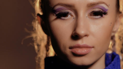 Beautiful woman with artificial eyelashes Stock Video Footage