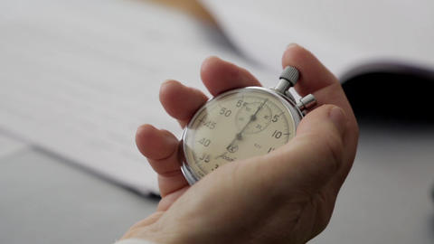 Close-up of a stopwatch in his hand Image