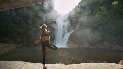 Girl Stands in Yoga Position against River Sun Rays Footage