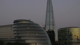 A tilt shot down the Shard in London to City Hall and the River Thames. Taken at Footage