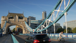 Traffic, cycles and pedestrians crossing Tower Bridge. Taken on the bridge in 4K Footage