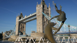 Static shot of Tower Bridge on a sunny morning. Framed by the statue of girl wit Footage