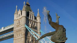 Static close shot of Tower Bridge and the dolphin statue. Taken on a clear, sunn Footage