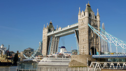The cruise ship Berlin passes under Tower Bridge on a bright sunny day. Footage  Footage