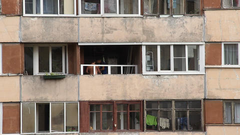 Worker install plastic window at recessed balcony, large apartment house Footage