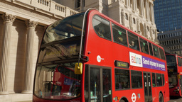 Tilt down the Bank of England with a red London double decker bus in front. Shot Footage