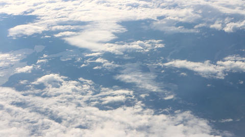 Under the wing 1. View on clouds from above Footage