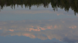 Evening sunset magic, which is reflected in slow waters of river Footage