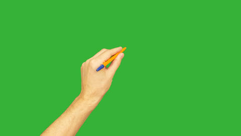 Male left hand holding pen for writing on green background. Alpha channel, keyed Image