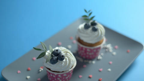 Two cupcakes on a rectangular plate Footage