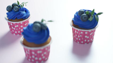Three cupcakes on a rectangular plate Image
