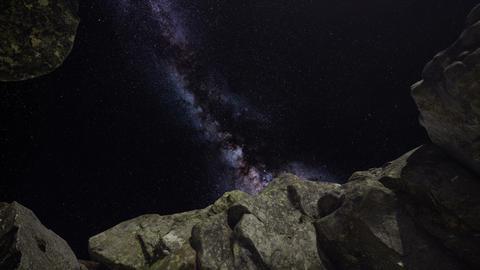 4K Astrophotography star trails over sandstone canyon walls ビデオ