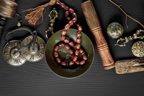 Copper singing bowl, prayer beads, prayer drum Photo