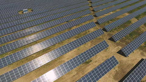 Industrial solar panel units desert environment producing renewable energy Footage