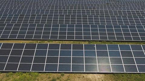 Solar panel units desert producing renewable energy Footage
