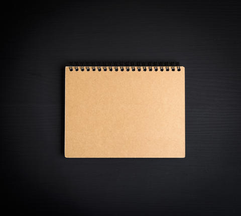 blank notepad with brown sheets Photo