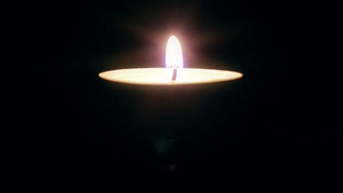 Single candle flame in the dark 4K Video Footage