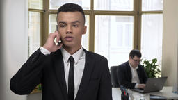 Young successful African businessman talking on a smartphone in the office, Man Footage