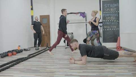 Fit young students exercising and preparing in a cross fit gym to obtain their Footage