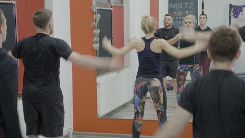 Group of male coworkers jumping and doing aerobic class together with their Footage