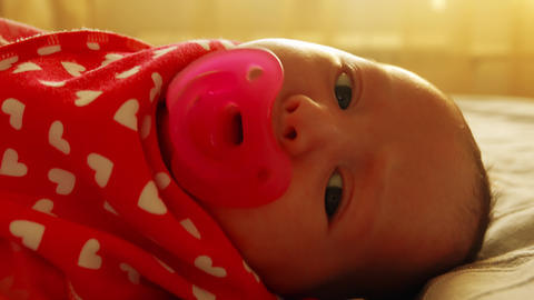 Newborn baby girl spits out the pacifier Footage