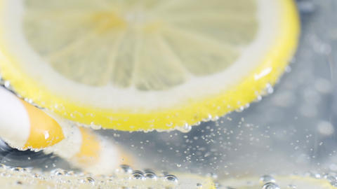 Lemon slice in soda water Footage