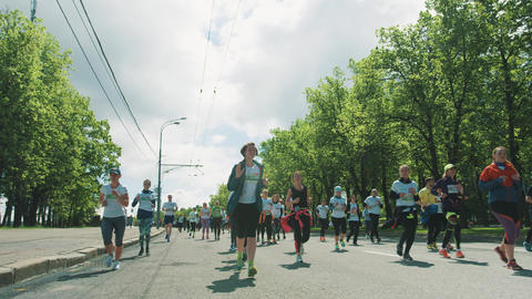 Group of runners jogging marathon in colorful sportive clothes Footage