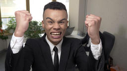 Young successful African businessman screams and raises his fists up, rejoices Footage