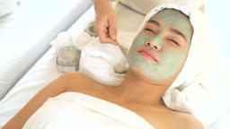 Face peeling mask, spa beauty treatment, skincare. Woman getting facial care by GIF