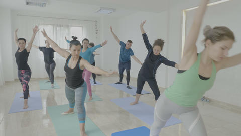 Women learning warrior pose during a yoga class as therapy to recover after Footage