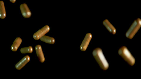 Pill capsules falling on the mirror table. Slowmotion shot, 180 fps ビデオ