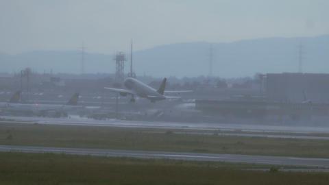 Airbus A320 take off through heavy rain Footage