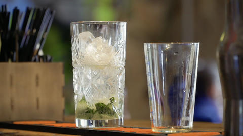 Cocktail with mineral water, pieces of cucumber and ice Footage